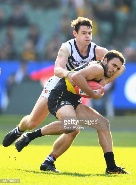 Shane Edwards of the Tigers is tackled by Lachie Neale of the Dockers during the round eight AFL match between the Richmond Tigers and the Fremantle...