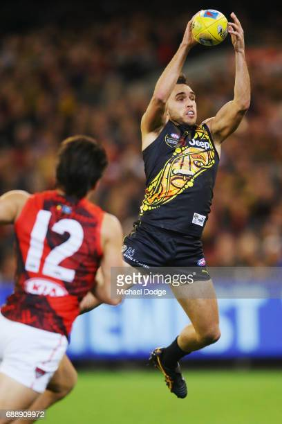 Shane Edwards of the Tigers marks the ball during the round 10 AFL match between the Richmond Tigers and the Essendon Bombers at Melbourne Cricket...