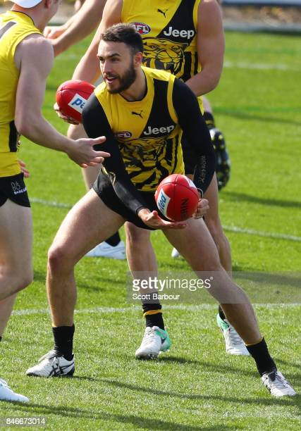 Shane Edwards of the Tigers runs with the ball during a Richmond Tigers AFL training session at Punt Road Oval on September 14 2017 in Melbourne...