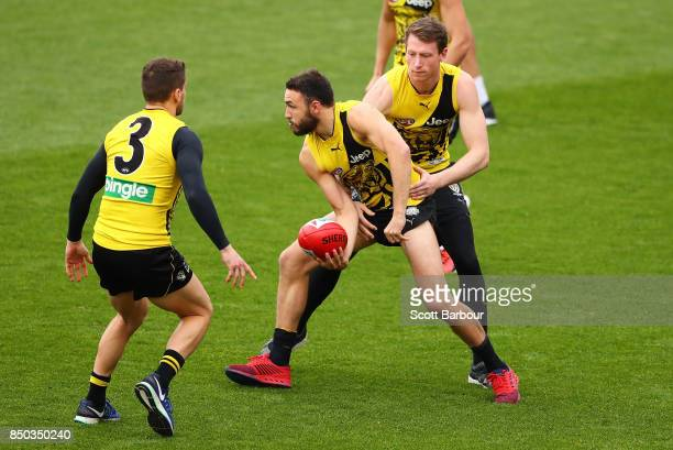Shane Edwards of the Tigers runs with the ball during a Richmond Tigers AFL training session at Punt Road Oval on September 21 2017 in Melbourne...