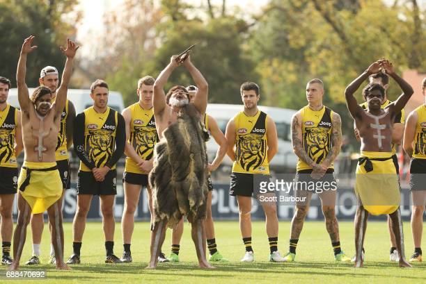 Shane Edwards Trent Cotchin and Dustin Martin of the Tigers look on as participants of the club's Korin Gamadji Institute perform a preview of the...