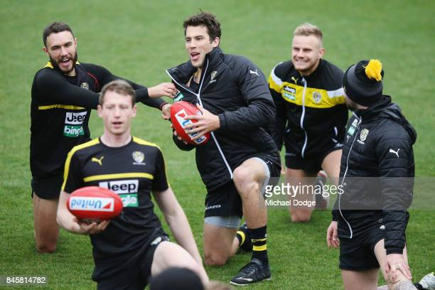 Shane Edwards tugs on the jmper of Alex Rance during a Richmond Tigers AFL training session at Punt Road Oval on September 12 2017 in Melbourne...