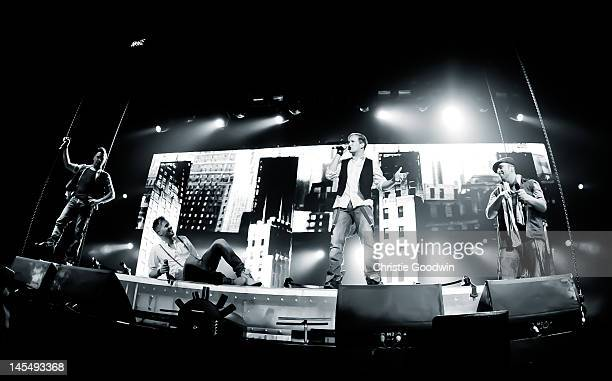 Shane Filan Nicky Byrne Kian Egan and Mark Feehily of Westlife perform on stage at the O2 Arena on March 12 2011 in London United Kingdom