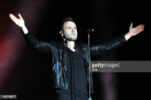 Shane Filan of Westlife performs on the stage at Hongshan Gymnasium as a part of Westlife 2012 World Farewell Tour on February 28 2012 in Wuhan China
