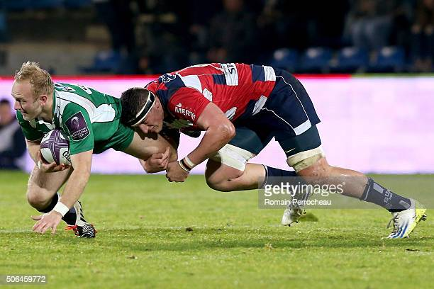Shane Geraghty for London Irish is tackled by Denis Marchois for Agen during the European Rugby Challenge Cup match between Agen and London rish at...