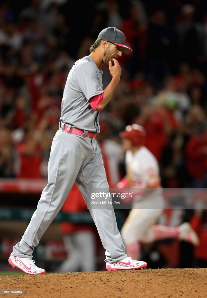 Shane Greene #61 of the Detroit Tigers walks back to the mound after allowing a solo homerun to Mike Trout #27 of the Los Angeles Angels of Anaheim during the seventh inning of a game at Angel Stadium of Anaheim on May 13, 2017 in Anaheim, California.