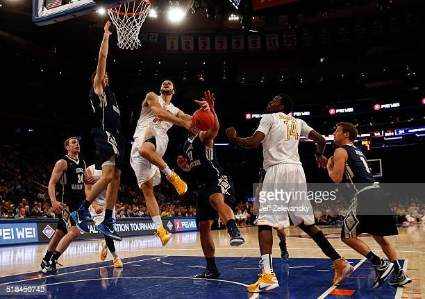 Shane Hamming of the Valparaiso Crusaders drives to the hoop against the George Washington Colonials during their NIT Championship game at Madison...