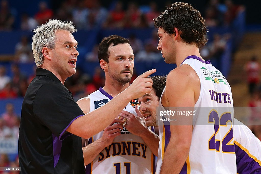 Shane Heal coach of the Kings talks with Aaron Bruce, Ben Madgen and Kevin White during the round 22 NBL match between the Perth Wildcats and the Sydney Kings at Perth Arena on March 8, 2013 in Perth, Australia.
