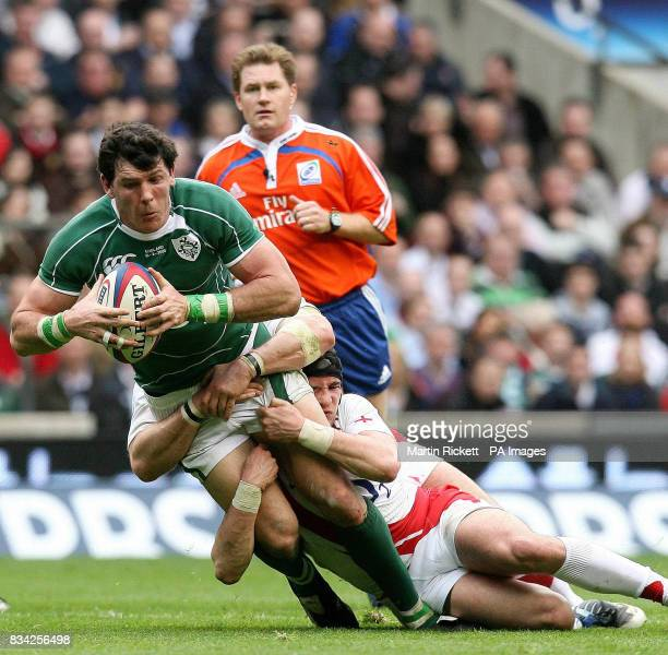 Shane Horgan is tacked by Danny Cipriani during the RBS 6 Nations match at Twickenham London