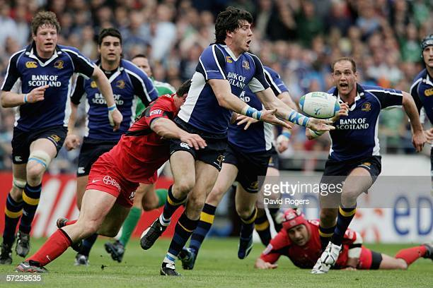 Shane Horgan of Leinster breaks away from Fabien Pelous of Toulouse to set up the first try during the Heineken Cup match between Toulouse and...