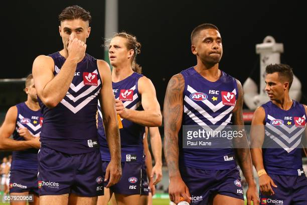 Shane Kersten and Bradley Hill of the Dockers walk from the field after being defeated during the round one AFL match between the Fremantle Dockers...