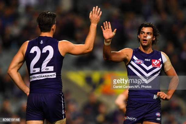 Shane Kersten and Brady Grey of the Dockers celebrates a goal during the 2017 AFL round 20 match between the Fremantle Dockers and the Gold Coast...