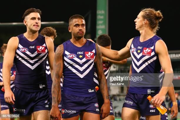 Shane Kersten Bradley Hill and Nathan Fyfe of the Dockers walk from the field after being defeated during the round one AFL match between the...