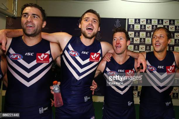 Shane Kersten Joel Hamling Lee Spurr and Cameron Sutcliffe of the Dockers sing the club song after winning the round nine AFL match between the...