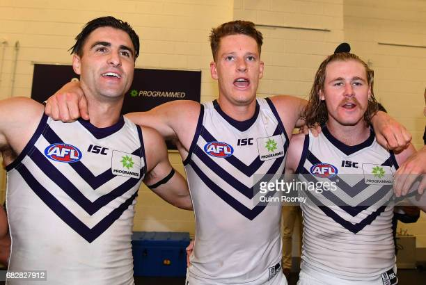Shane Kersten Matt Taberner and Cam McCarthy of the Dockers sing the song in the rooms after winning the round eight AFL match between the Richmond...