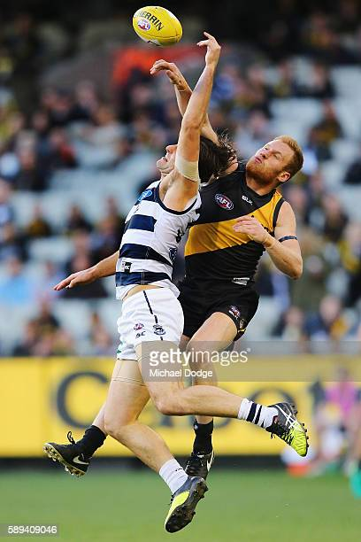 Shane Kersten of the Cats and Nick Vlastuin of the Tigers compete for the ball during the round 21 AFL match between the Richmond Tigers and the...