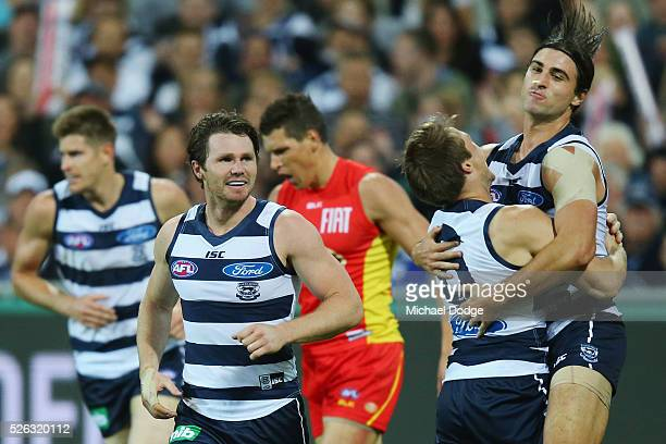Shane Kersten of the Cats celebrates a goal with Jake Kolodjashnij and Patrick Dangerfield during the round six AFL match between the Geelong Cats...