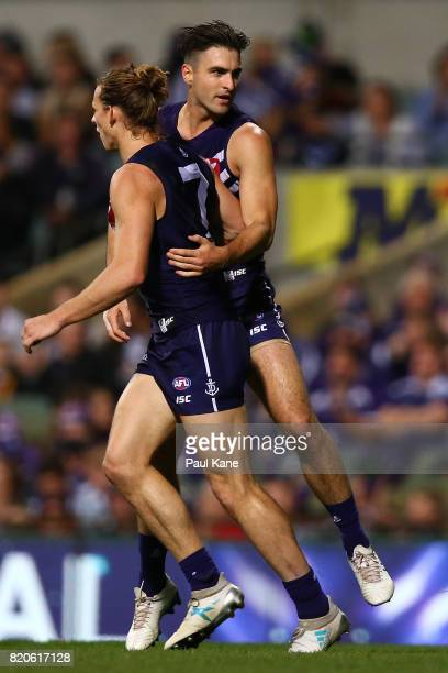 Shane Kersten of the Dockers celebrates a goal with Nathan Fyfe during the round 18 AFL match between the Fremantle Dockers and the Hawthorn Hawks at...