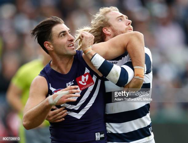 Shane Kersten of the Dockers competes for the ball with former teammate Cameron Guthrie of the Cats during the 2017 AFL round 14 match between the...