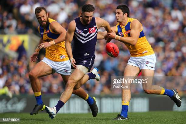 Shane Kersten of the Dockers contests for the ball against Tom Barrass of the Eagles during the round 17 AFL match between the Fremantle Dockers and...