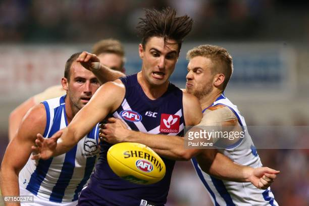 Shane Kersten of the Dockers gets tackled by Ed VickersWillis of the Kangaroos during the round five AFL match between the Fremantle Dockers and the...