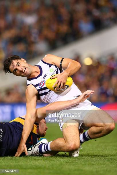 Shane Kersten of the Dockers gets tackled by Jeremy McGovern of the Eagles during the round six AFL match between the West Coast Eagles and the...