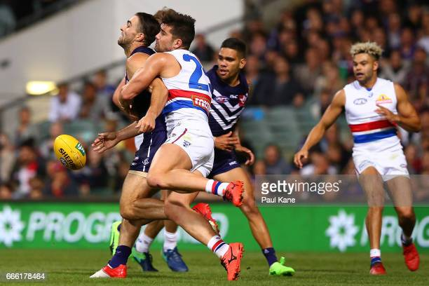 Shane Kersten of the Dockers gets tackled by Marcus Adams of the Bulldogs during the round three AFL match between the Fremantle Dockers and the...