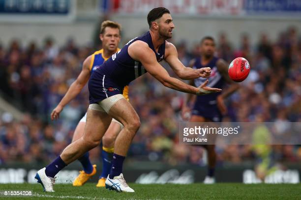 Shane Kersten of the Dockers handballs during the round 17 AFL match between the Fremantle Dockers and the West Coast Eagles at Domain Stadium on...