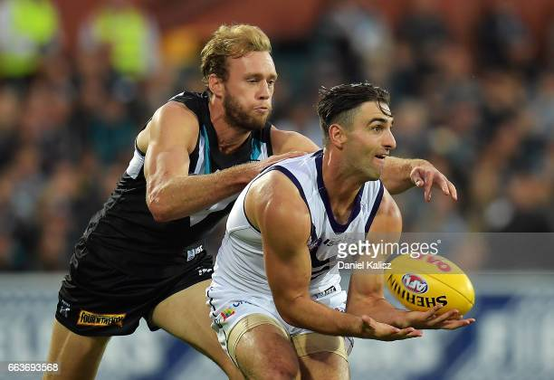Shane Kersten of the Dockers handballs during the round two AFL match between the Port Adelaide Power and the Fremantle Dockers at Adelaide Oval on...