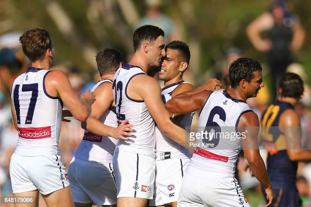 Shane Kersten of the Dockers is congratulated after kicking a goal during the JLT Community Series AFL match between the West Coast Eagles and the...