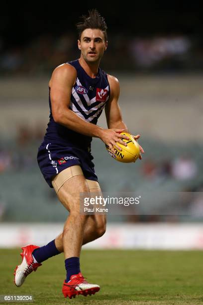 Shane Kersten of the Dockers looks to pass the ball during the JLT Community Series AFL match between the Fremantle Dockers and the Carlton Blues at...