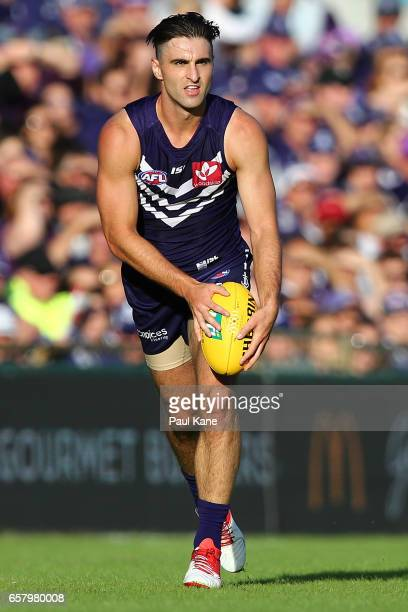 Shane Kersten of the Dockers looks to pass the ball during the round one AFL match between the Fremantle Dockers and the Geelong Cats at Domain...