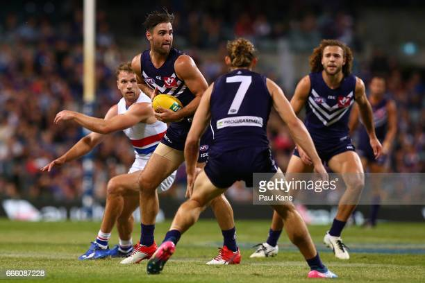 Shane Kersten of the Dockers looks to pass the ball during the round three AFL match between the Fremantle Dockers and the Western Bulldogs at Domain...