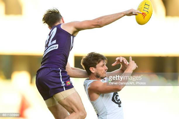 Shane Kersten of the Dockers makes contact with Alex Silvagni of the Blues in spoil attempt during the AFL 2017 JLT Community Series match between...