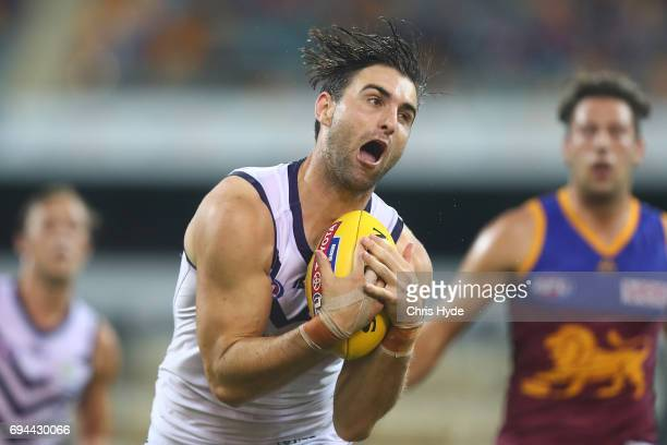 Shane Kersten of the Dockers marks during the round 12 AFL match between the Brisbane Lions and the Fremantle Dockers at The Gabba on June 10 2017 in...