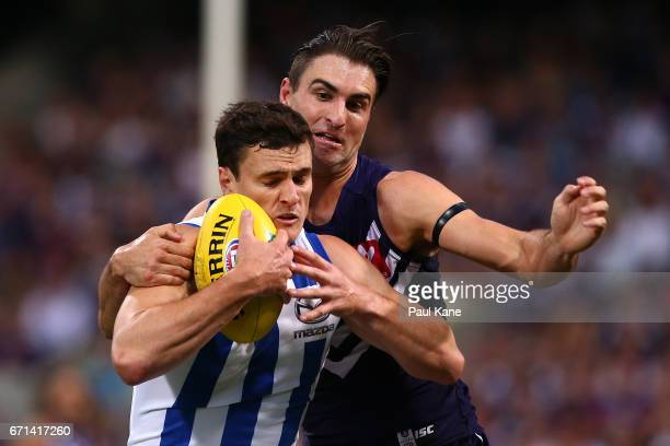 Shane Kersten of the Dockers tackles Scott Thompson of the Kangaroos during the round five AFL match between the Fremantle Dockers and the North...