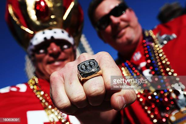 Shane Knight and Jimmy Bowers fans of the San Francisco 49ers show support for their team outside the stadium prior to Super Bowl XLVII against the...