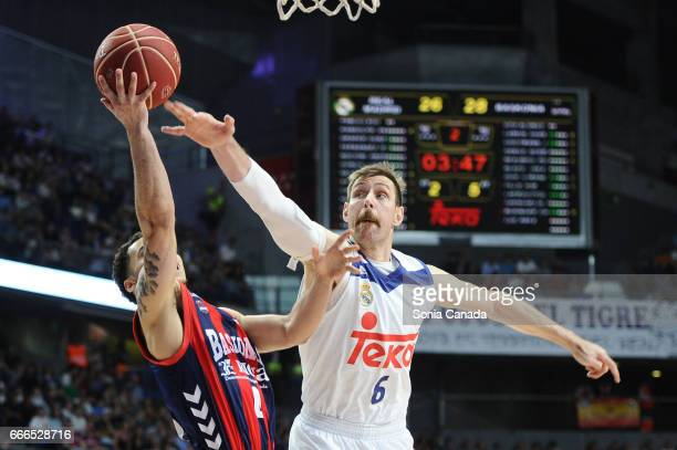 Shane Larkin #0 guard of Baskonia and Andres 'Chapu' Nocioni #6 forward of Real Madrid during the Liga Endesa game between Real Madrid and Baskonia...