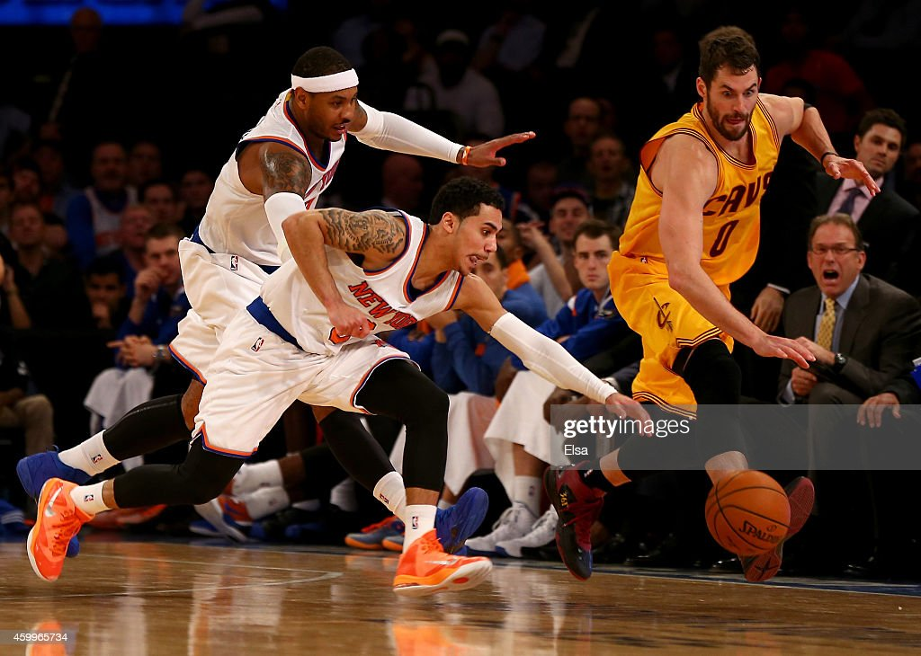 Shane Larkin and Carmelo Anthony of the New York Knicks chase after the loose ball with Kevin Love of the Cleveland Cavaliers in the fourth quarter...