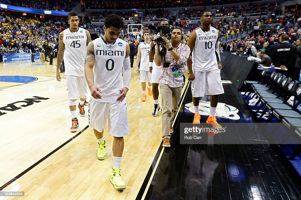Shane Larkin #0, Julian Gamble #45 and Raphael Akpejiori #10 of the Miami (Fl) Hurricanes walk off of the court after losing to the Marquette Golden Eagles during the East Regional Round of the 2013 NCAA Men's Basketball Tournament at Verizon Center on March 28, 2013 in Washington, DC.