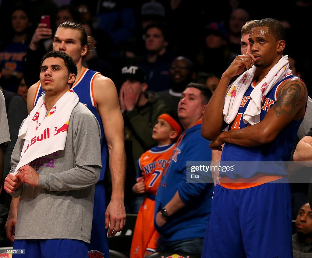 Shane Larkin #0 Lou Amundson #21 and Lance Thomas #42 of the New York Knicks react to the loss against the Brooklyn Nets at the Barclays Center on February 6, 2015 in the Brooklyn borough of New York City.The Brooklyn Nets defeated the New York Knicks 92-88.