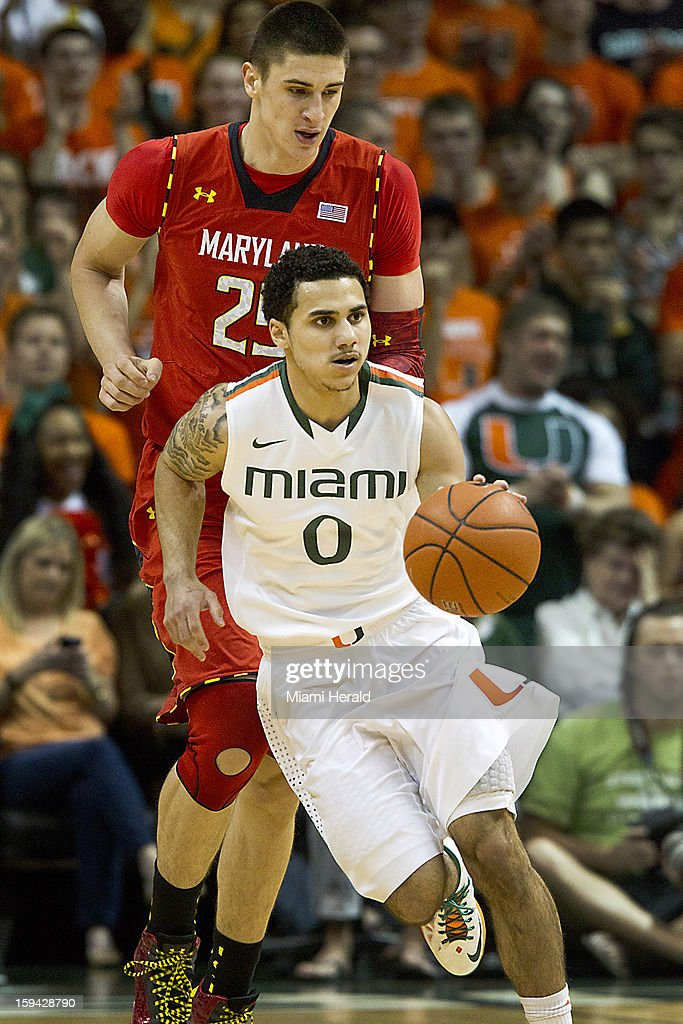 Shane Larkin of Miami leads the break with Alex Len of Maryland trailing in the first half of a men's college basketball game at the BankUnited Center on Sunday, January 13, 2013, in Coral Gables, Florida.