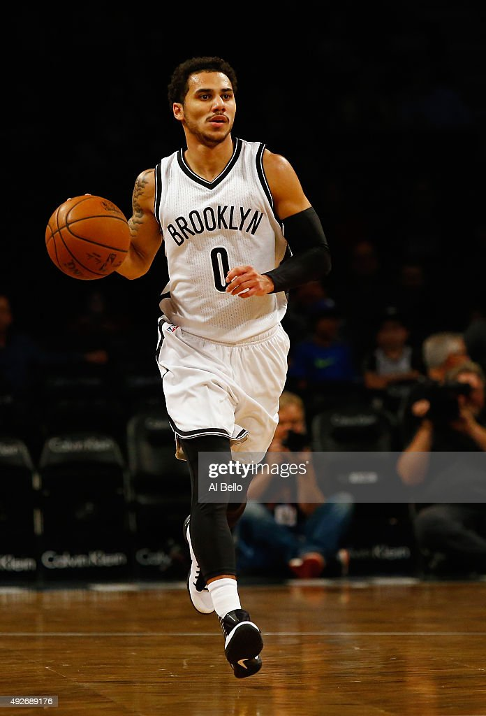 Shane Larkin of the Brooklyn Nets brings the ball up court against the Boston Celtics during their Preseason game at Barclays Center on October 14...