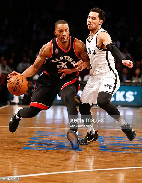 Shane Larkin of the Brooklyn Nets guards Norman Powell of the Toronto Raptors during their game at the Barclays Center on April 13 2016 in New York...