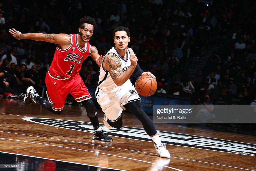 Shane Larkin of the Brooklyn Nets handles the ball against Derrick Rose of the Chicago Bulls on October 28 2015 at Barclays Center in Brooklyn New...