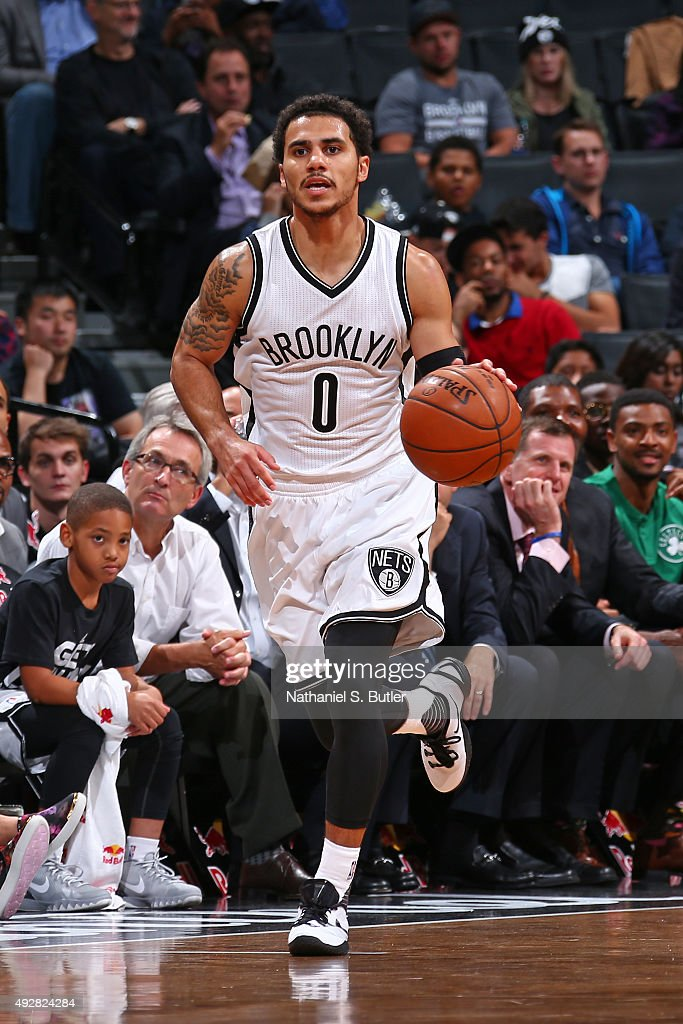 Shane Larkin of the Brooklyn Nets handles the ball against the Boston Celtics during the preseason game on October 14 2015 at Barclays Center in...