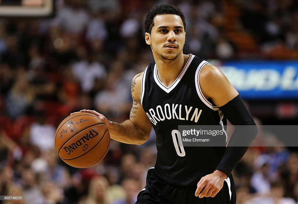 Shane Larkin of the Brooklyn Nets looks to pass during a game against the Miami Heat at American Airlines Arena on December 28 2015 in Miami Florida...