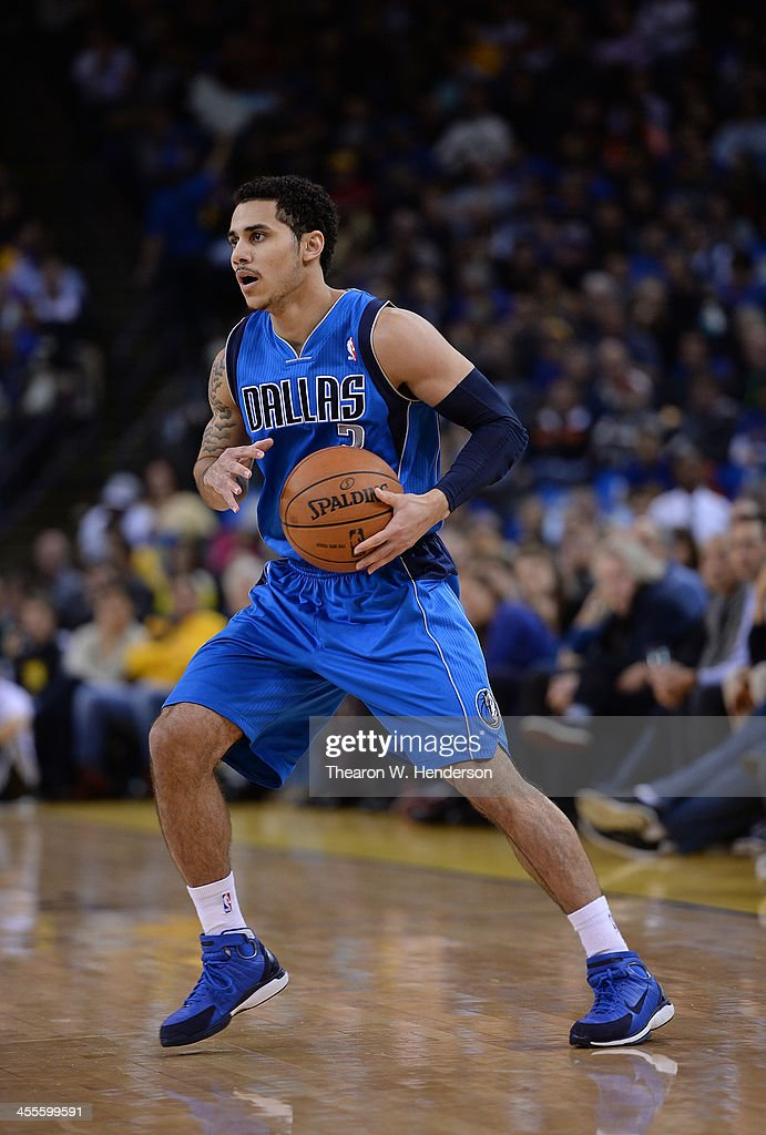 Shane Larkin of the Dallas Mavericks dribbles the ball against the Golden State Warriors at ORACLE Arena on December 11 2013 in Oakland California...