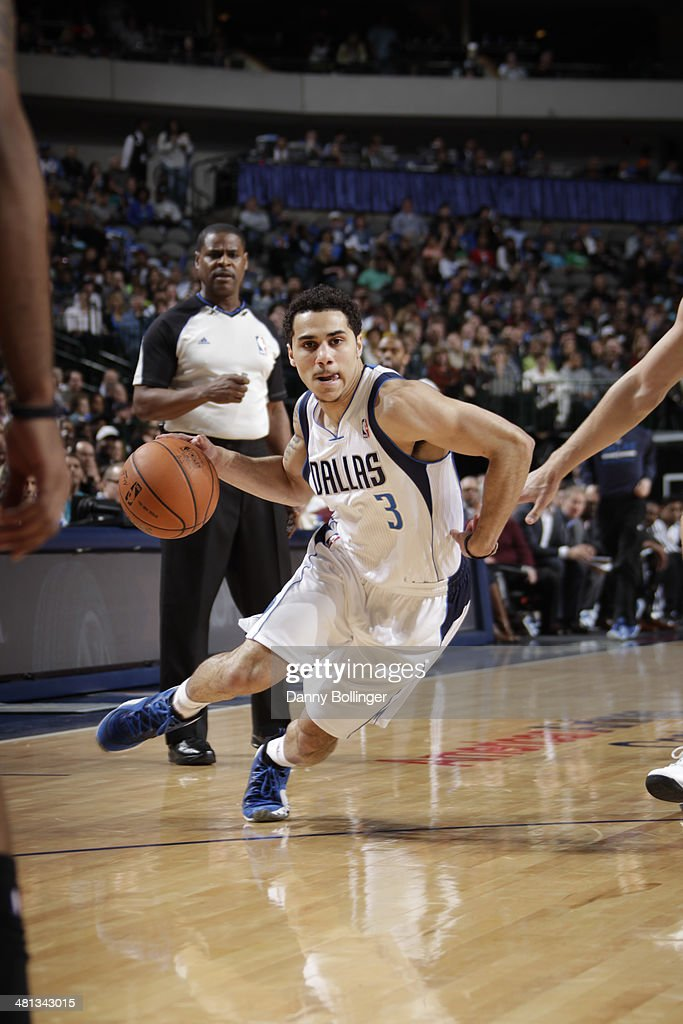 Shane Larkin of the Dallas Mavericks drives against the Brooklyn Nets on March 23 2014 at the American Airlines Center in Dallas Texas NOTE TO USER...
