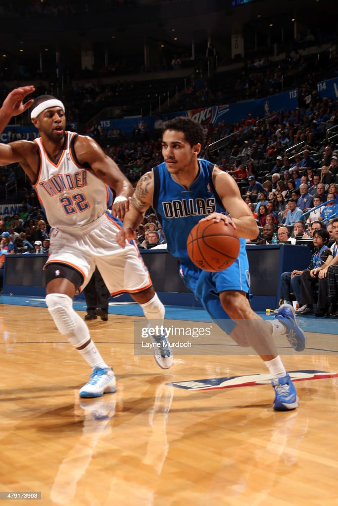 Shane Larkin of the Dallas Mavericks drives against the Oklahoma City Thunder on March 16 2014 at the Chesapeake Energy Arena in Oklahoma City...